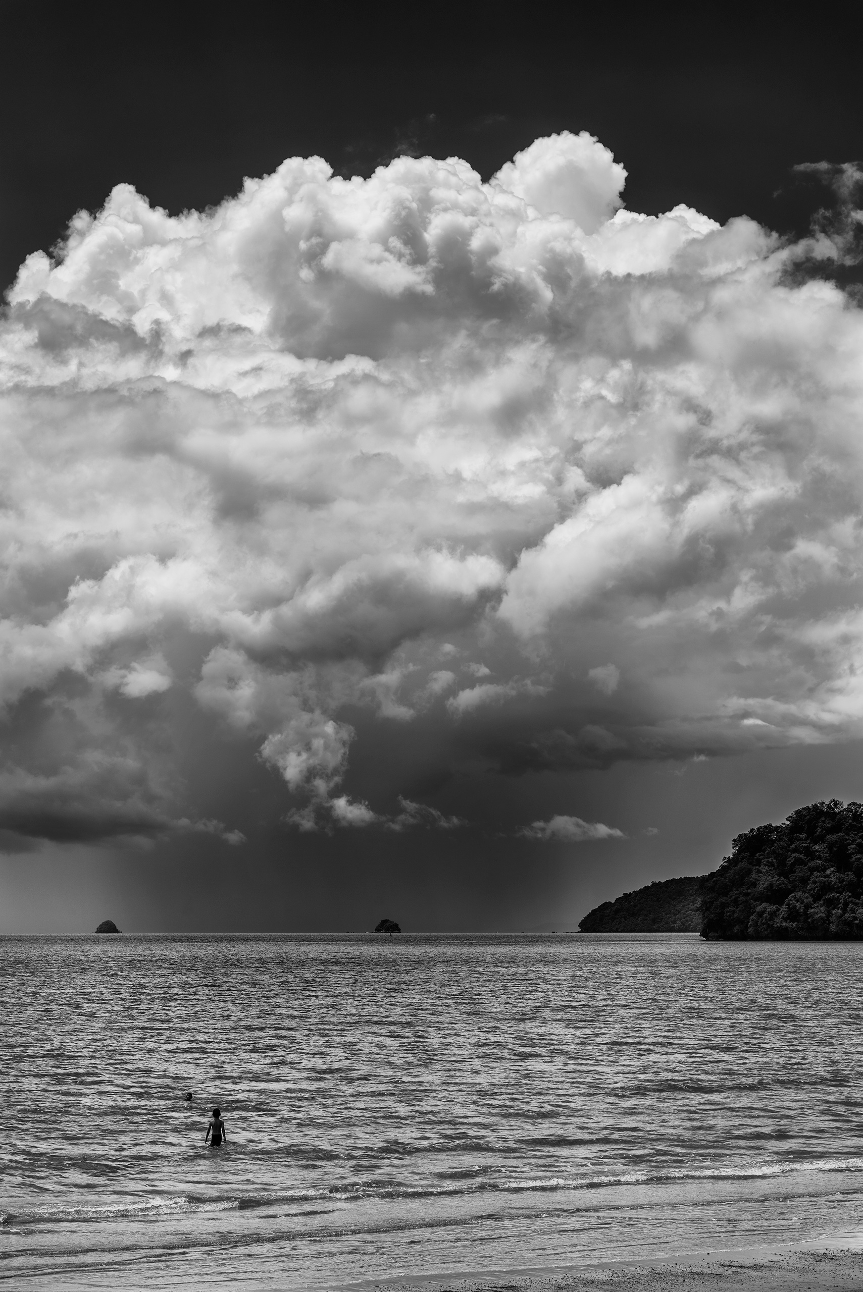 boys awaiting storm - ocean, monsoon - christofkessemeier | ello