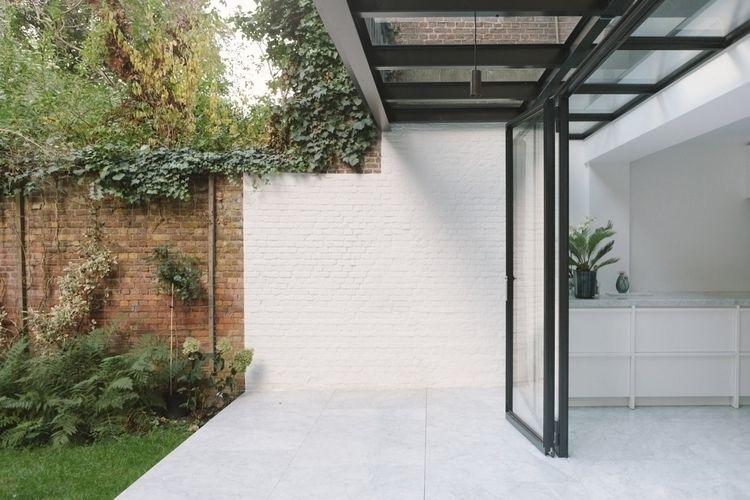 Covered patio. House Antwerp Ha - upinteriors | ello