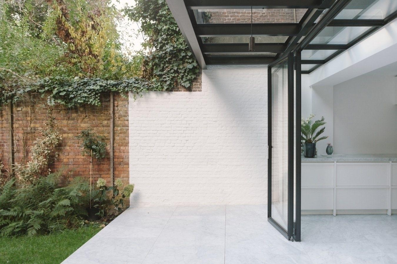 Covered patio. House Antwerp Ha - upinteriors   ello
