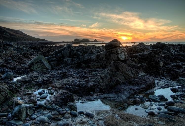 Clonque Sunset - rocks fort Ald - neilhoward   ello