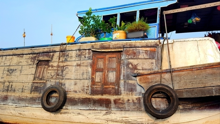 houseboat Tho floating market - Vietnam - juliandasilva | ello