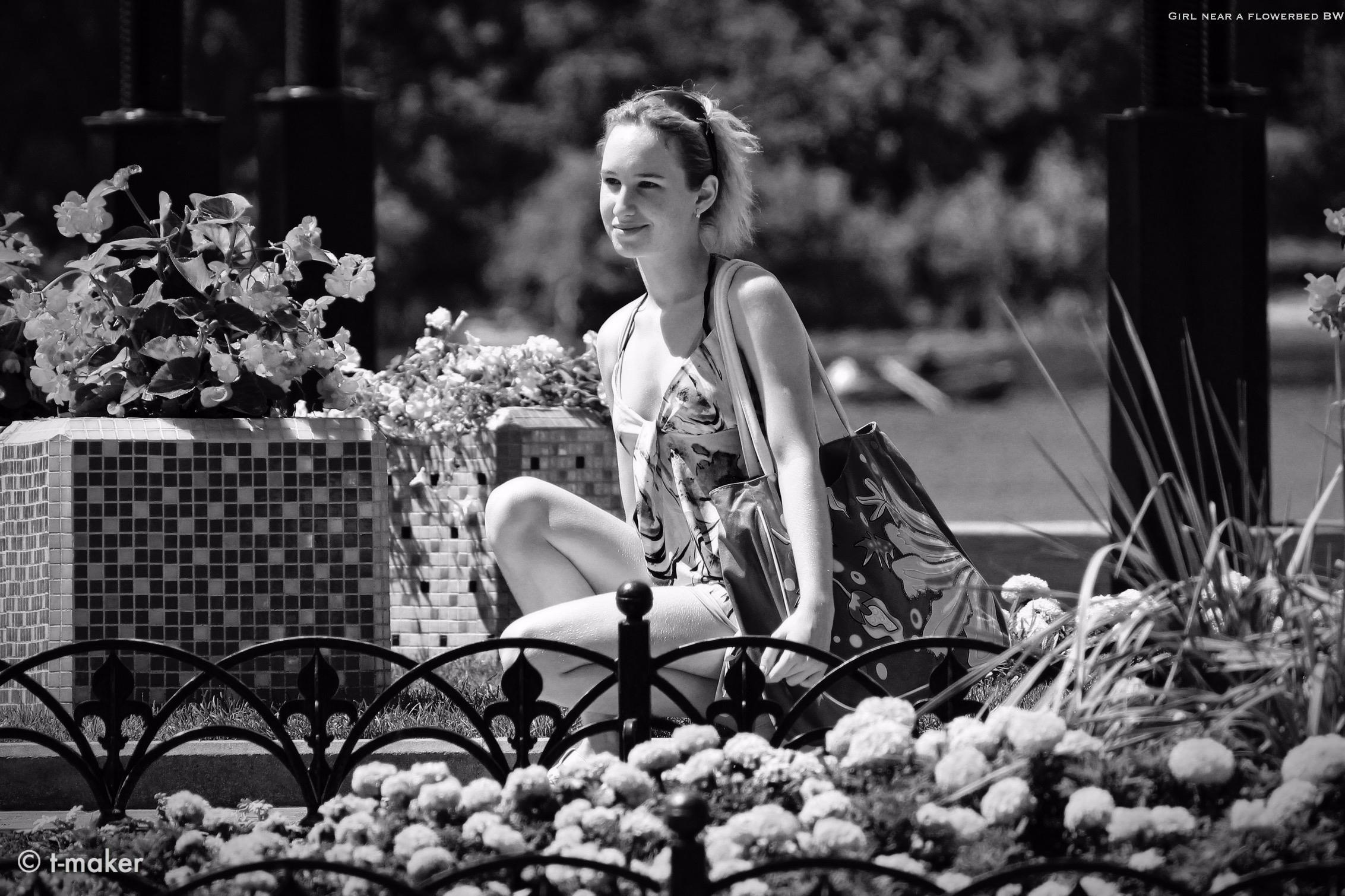 Girl flowerbed BW | Flickr: Dev - t-maker | ello