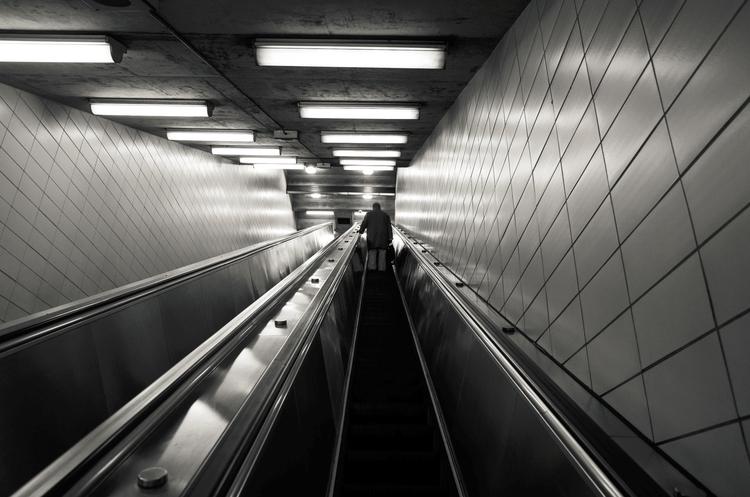 Lonely traveler escalator, Toro - seanrasmussen | ello