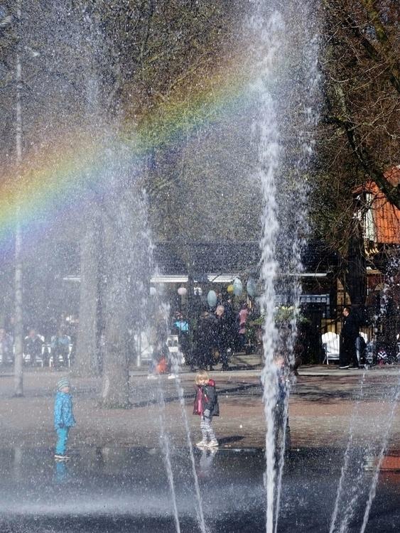 rainbow - children playing foun - thesupercargo | ello