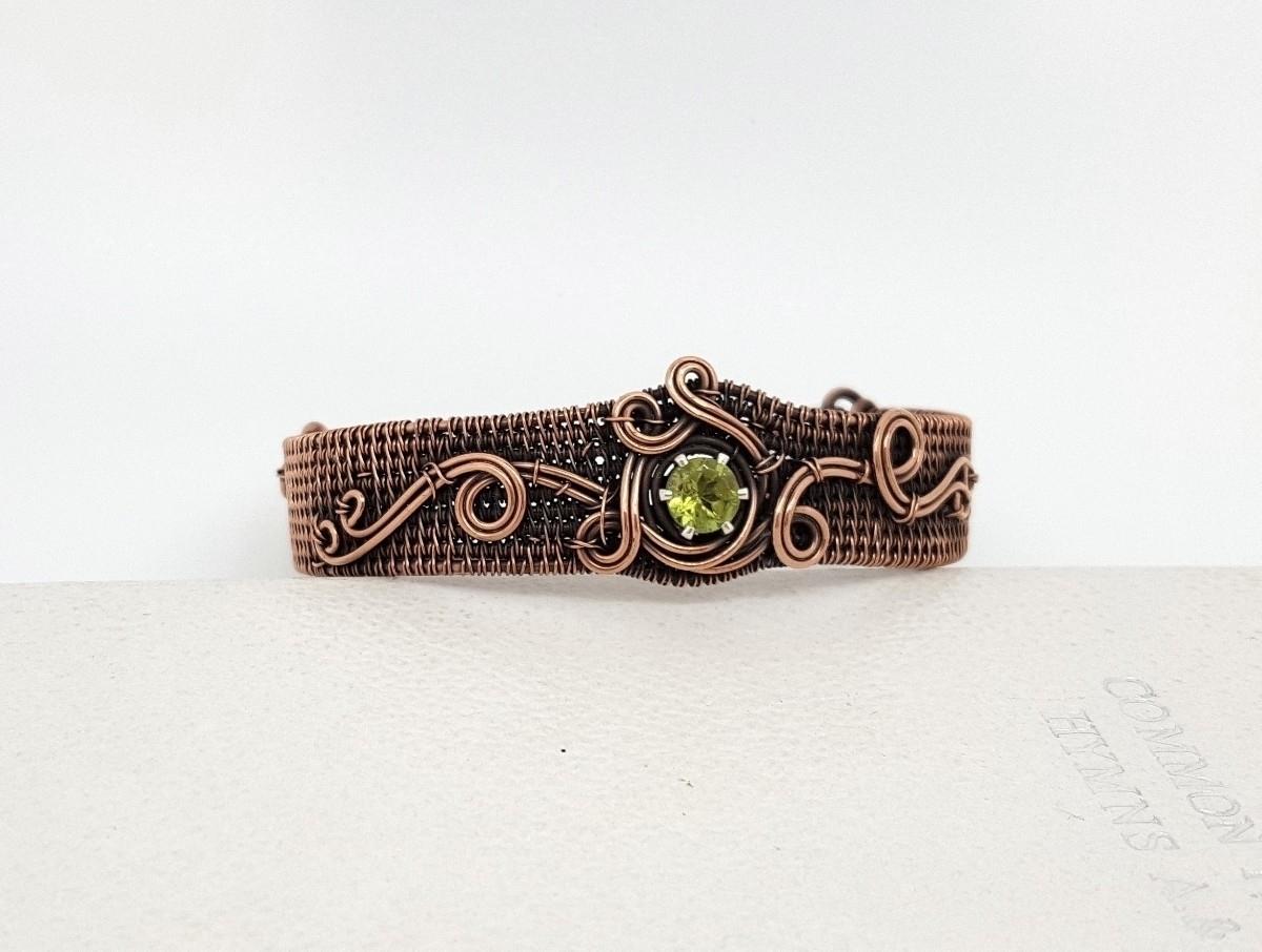 Peridot hand woven copper brace - jakdawgems | ello