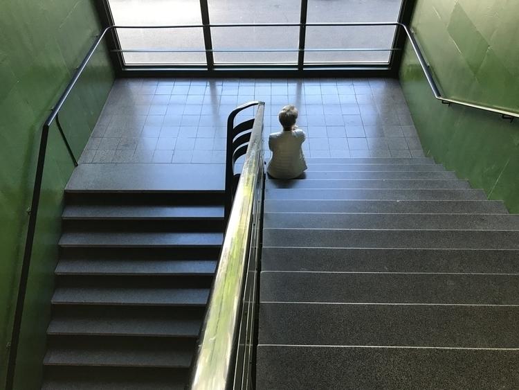 Woman sitting green staircase - artbasel - partof_shan | ello