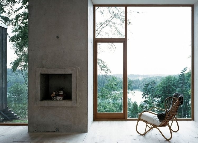 Concrete fireplace large window - upinteriors | ello