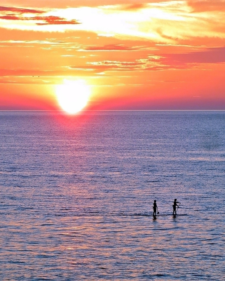 Sunset paddle surfers Lake Erie - kenlong | ello
