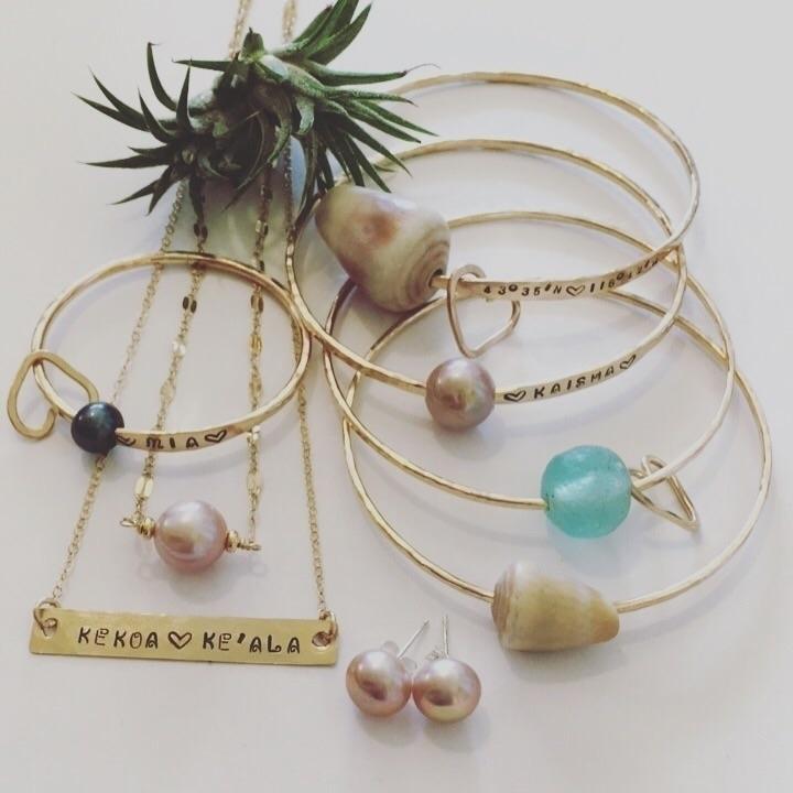 Text custom pieces  - kauaimadejewelry#hawaiianstyle#handstampedjewelry#oneofakind#armcandy#banglelovers#edisonpearls#kauaishells#kauaimade#kauaifound#designyourownpieces#handcraftedjewelryinkauai#ahonuexperience#ahonuexperiencejewelry - ahonuexperience | ello