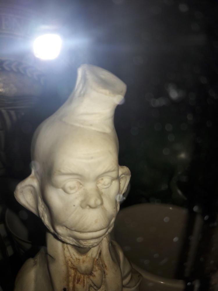 Odd statue dug earth - silhouett | ello