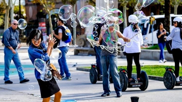 bubble street artist playing pe - shutterstalk | ello
