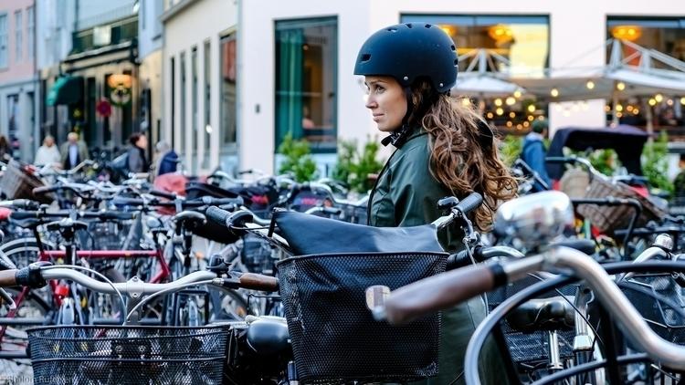 Pretty girl ocean bikes, Copenh - shutterstalk | ello