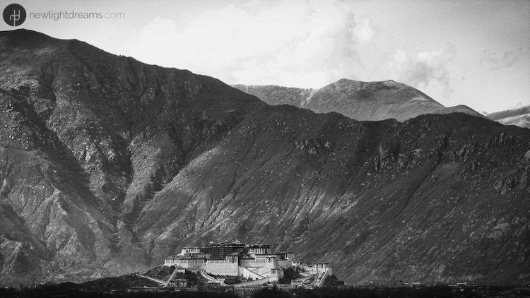 distant Potala Palace nestled - Himalaya - newlightdreams | ello