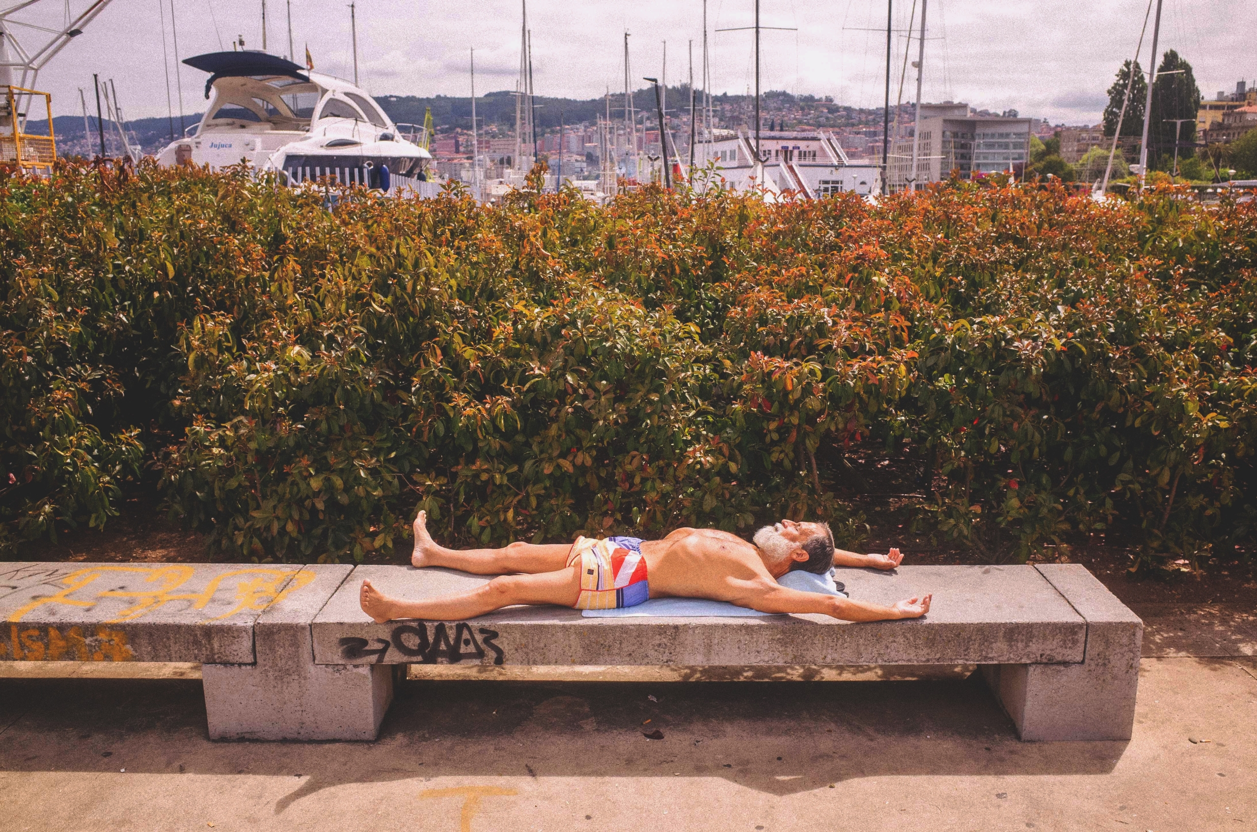 man sunbathing pier - photography - escot | ello