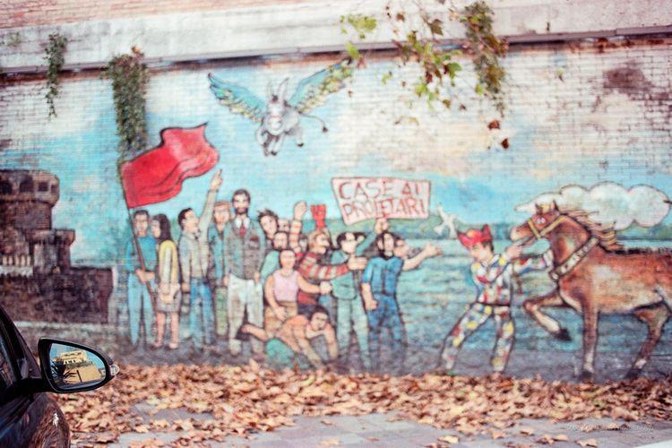 story murals written nearby: Da - bampgs | ello