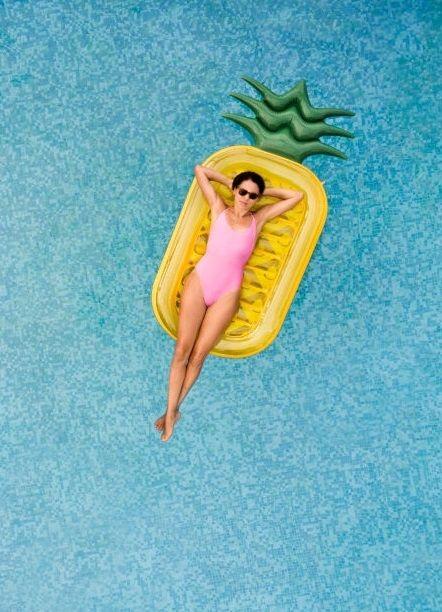 Woman Inflatable Pineapple. Vis - kh-zain | ello